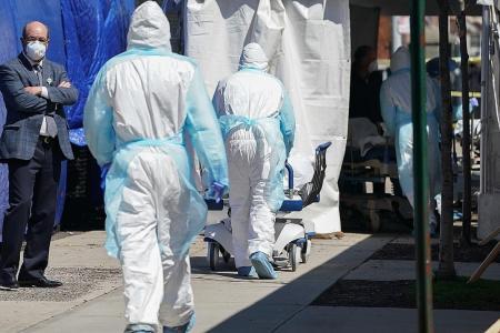Coronavirus: US fatalities pass 10,000, NY morgues struggle to cope