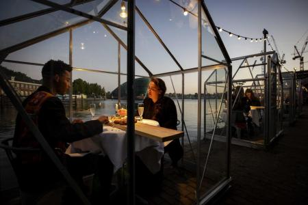 Dutch eatery trials greenhouses for socially-distant dining