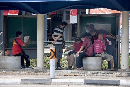 Betting activity at Marsiling bus stop?