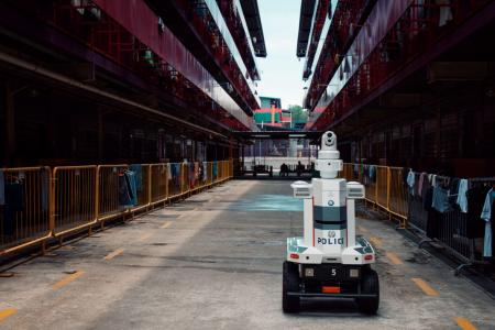 Police deploy robots to patrol workers' dorms, ensure safe distancing