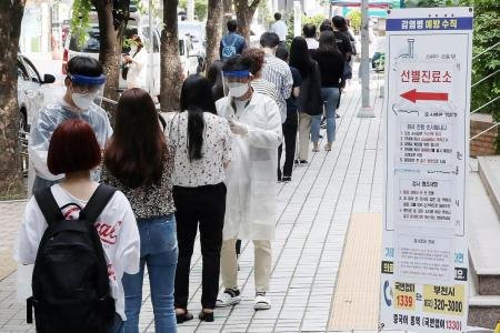 South Korea re-imposes curbs after 79 cases reported