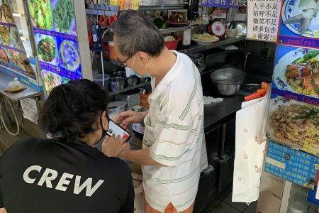 Non-profit food delivery platform helps hawkers go online