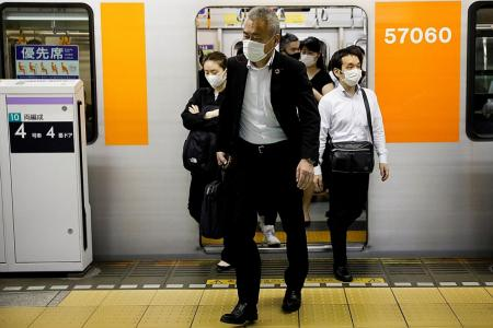 Japan's 'mosh pit' trains raise fears of resurgence in infections
