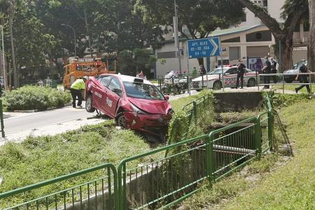 Cabby taken to hospital after his taxi lands in 3m-deep ditch
