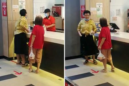 Woman charged after viral video of spitting incident at KFC