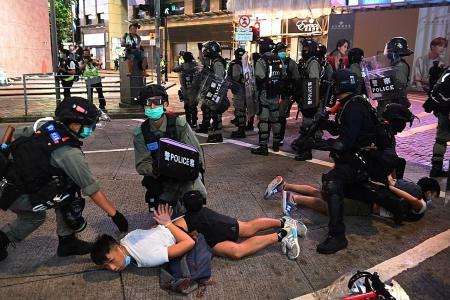 HK cops detain over 300 protesters, nine arrests involve new law