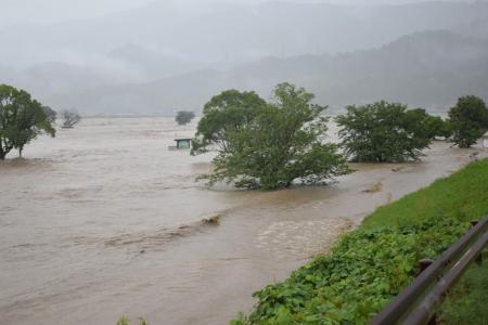 Japan floods, mudslides kill at least 44 as streets turn to rivers