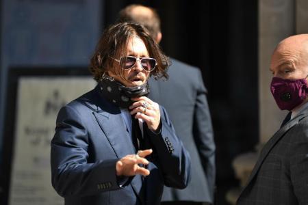 Johnny Depp denies 'wife-beater' claim in London libel trial