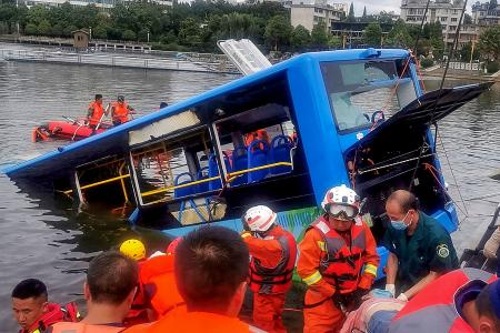 21 dead after bus plunges into lake in south-western China