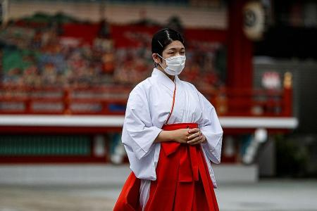 Tokyo raises virus alert to highest 'red', situation 'rather severe'