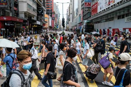 HK reports 73 new cases as health experts call for tougher measures