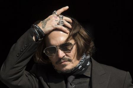 Heard says Depp threw bottles 'like grenades', hit him in self-defence