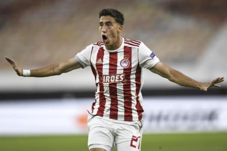 Liverpool sign Greek left-back Kostas Tsimikas from Olympiakos