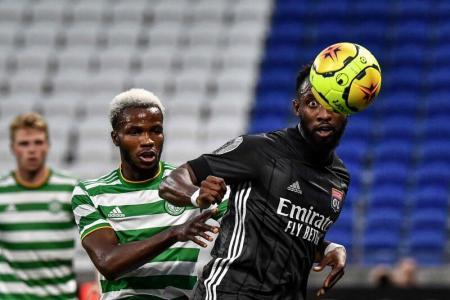 Celtic defender Boli Bolingoli (left).