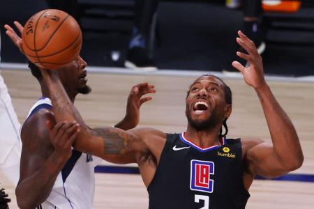 Kawhi Leonard, Paul George help Clippers rally to beat Mavericks