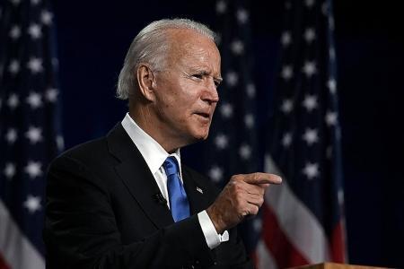 Biden condemns Trump for 'walking away' as coronavirus ravages the US