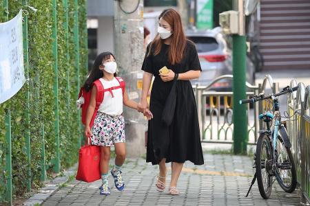 S. Korea closes most schools in Seoul area amid resurgence