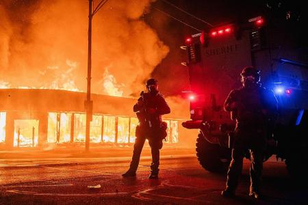 Buildings on fire as US city rages over police shooting of black man