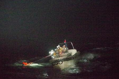 Ship with 43 sailors capsizes in storm, only one found so far