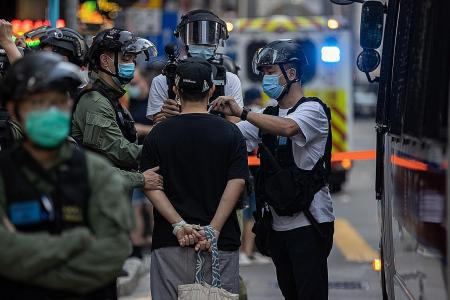 Hong Kong police fire pepper balls at protesters, 90 arrested