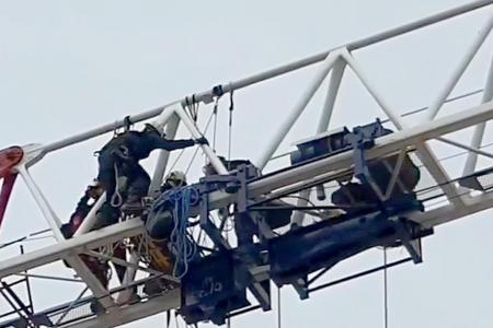 Injured worker rescued from 40m-tall crane
