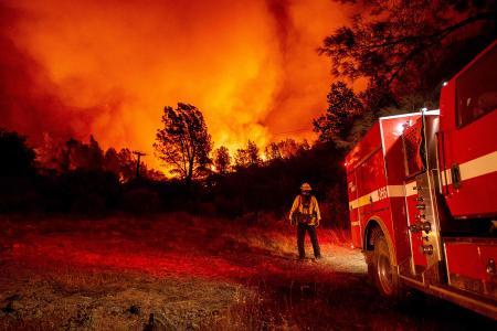 Wildfires destroy Washington town, roar through California, Oregon