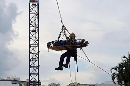 Treating injured worker dangling 40m in the air