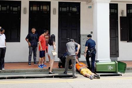 Man restrained by passers-by died of 'natural disease process'