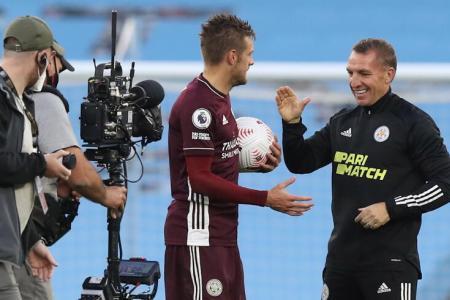 Brendan Rodgers (right) congratulates striker Jamie Vardy.