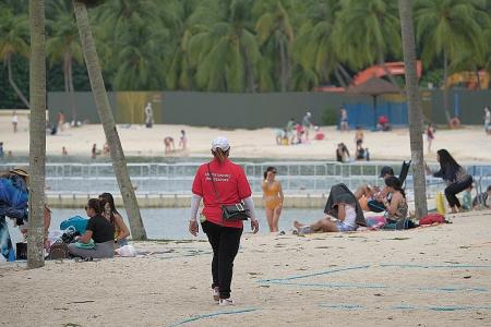 Crowds hit Sentosa beaches ahead of new rule