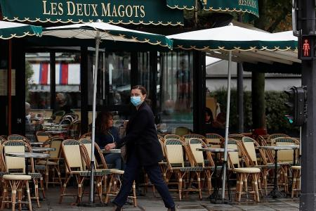 Paris shuts bars for two weeks to fight rapid spread of virus
