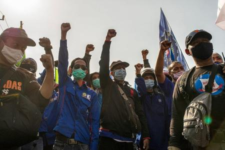 Thousands of Indonesians protest against passage of jobs Bill