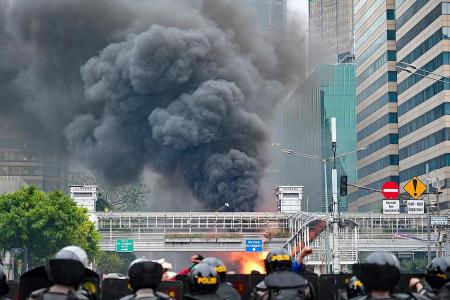 Cops and protesters clash for third day over Indonesia's new jobs law