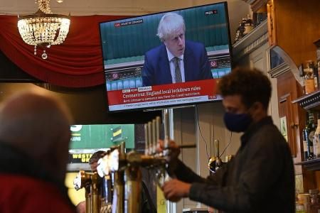 UK PM Johnson imposes further curbs, closes pubs in Merseyside