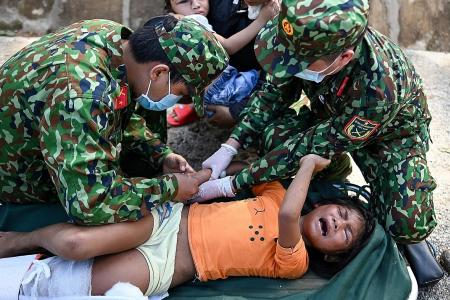 Vietnam searches for survivors after typhoon triggers landslides