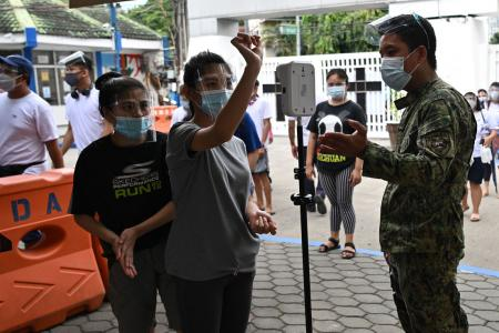 Coronavirus cases in the Philippines fell by 25% cent last month