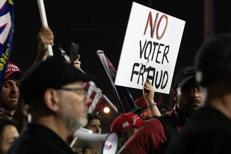 Trump supporters protest outside Arizona vote centre, some are armed