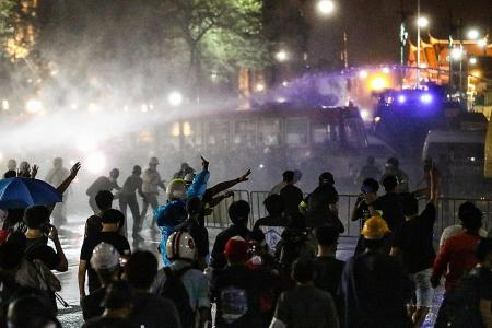 Thai police use water cannon against thousands of protesters