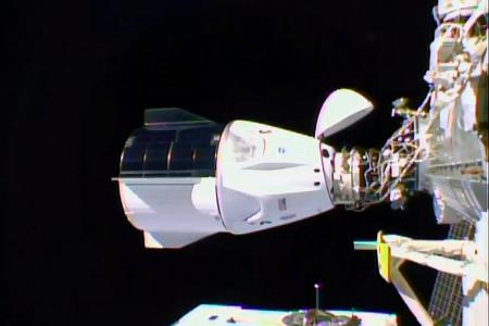 Privately owned spacecraft docks with International Space Station