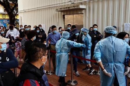 Hong Kong tightens virus curbs, cuts meetups to two people