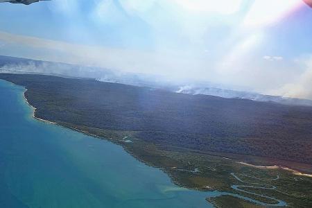 Bush fire forces evacuation of township on Australia's Fraser Island