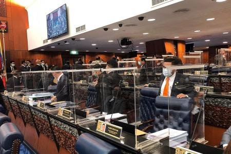 Quarantined ministers enter Malaysia Parliament, opposition walks out