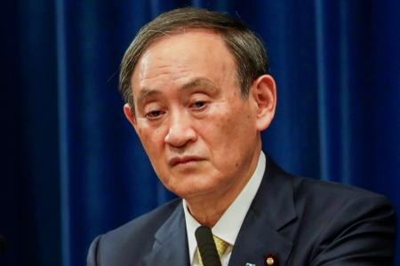 PM criticised for attending year-end dinners in coronavirus-hit Japan