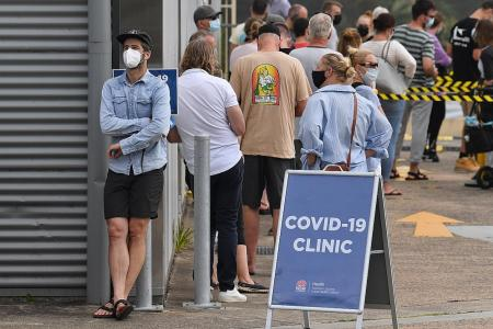 Officials rush to trace source of Covid cluster as Sydney cases rise