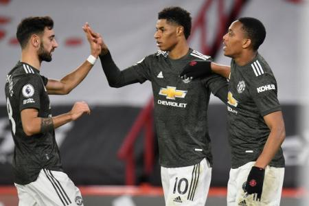 Rashford's double helps Manchester United extend perfect away record