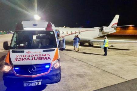 Couple with Covid-19 make it back to Singapore via air ambulance