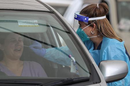 Australia confirms two cases of new virus strain spreading in Britain