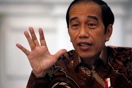 Under-fire health minister dropped in Indonesian Cabinet reshuffle