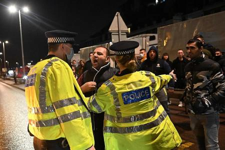 Furious truckers stuck in UK due to Covid blockade scuffle with cops