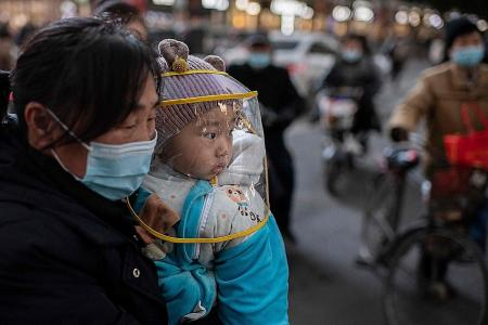 China reports over 100 new infections ahead of New Year travel exodus